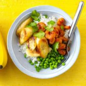 Fried marinated shrimp With peas, rice and fried banana